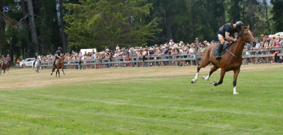 Glenorchy rider Calder Houliston (right) and his horse Harry on the home straight in the...