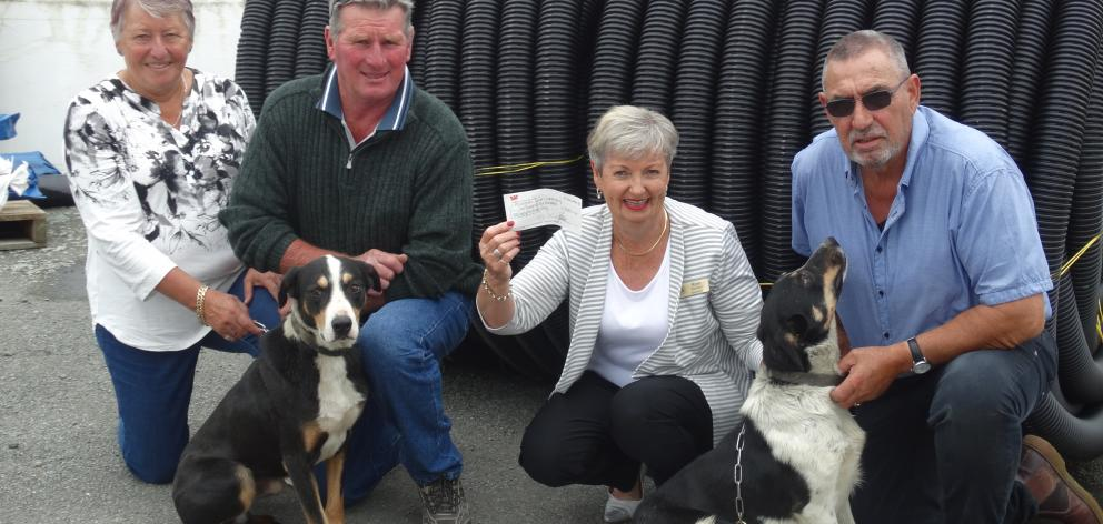 Rose Davidson (second from right), of Alzheimers South Canterbury, holds a cheque for money raised by local dog triallists. With her are (from left) Ali and Chris Calder and Kevin Ashworth. Photo: Chris Tobin