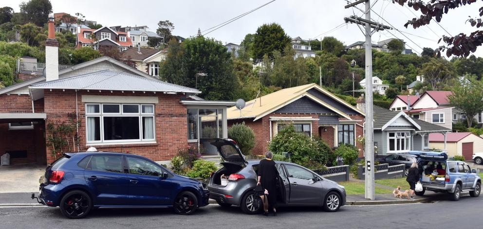 Residents in Motu St,  St Clair, move out in mid-December amid fears of a slip behind their...