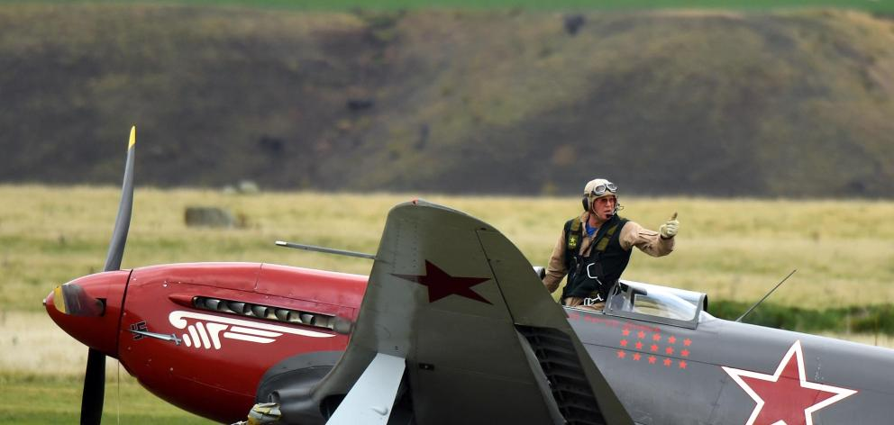 Yak-3 pilot Arthur Dovey signals he is unhurt after the aircraft he was landing collided with a cherry picker on the grass runway at Warbirds over Wanaka in March last year. Photo: Stephen Jaquiery