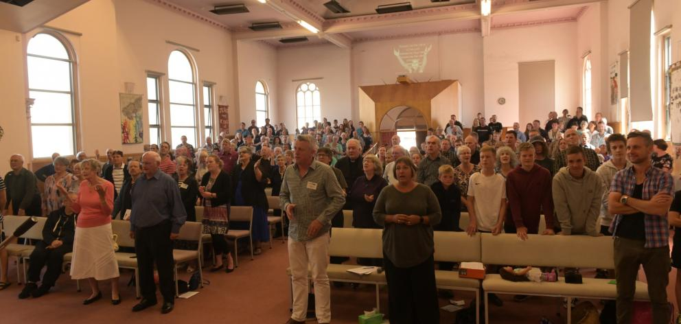A packed church sings during Roly and Trudy Scott's farewell service. Photos: Linda Robertson