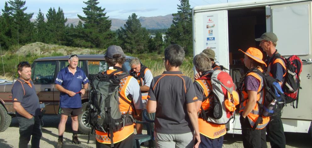 Central Otago LandSAR operations manager Adrian ''Snow'' Dance briefs volunteers before Saturday...