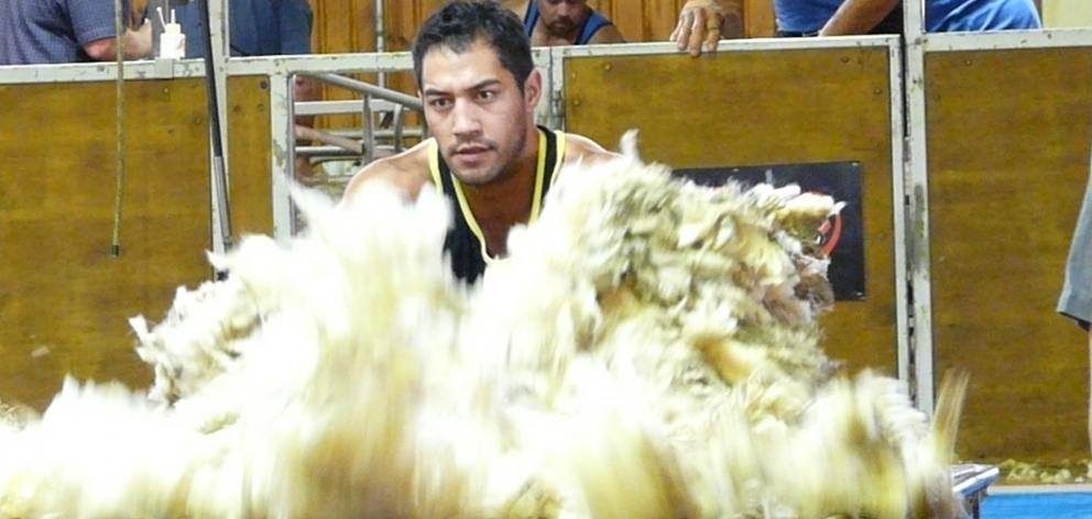 Current world champion, Joel Henare, of Gisborne, won the Otago Open Woolhandling championship in...