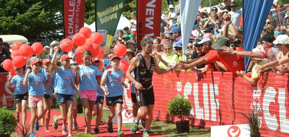 A large crowd on the Wanaka lakefront cheers as Christchurch's Dylan McNeice wins the 2015 event....