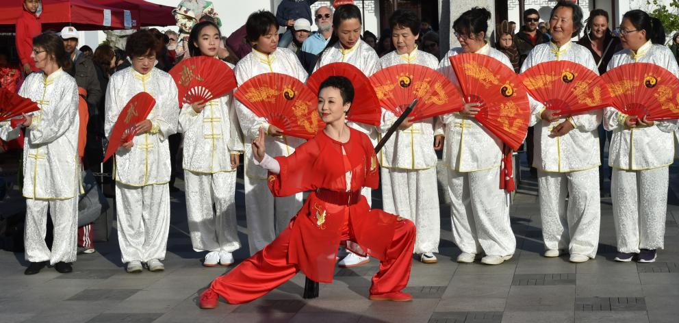 Susan Xu (48) and other members of the Dunedin Tai Chi Club join the festivities while celebrating Chinese New Year at the Dunedin Chinese Garden last night. Photo: Gregor Richardson