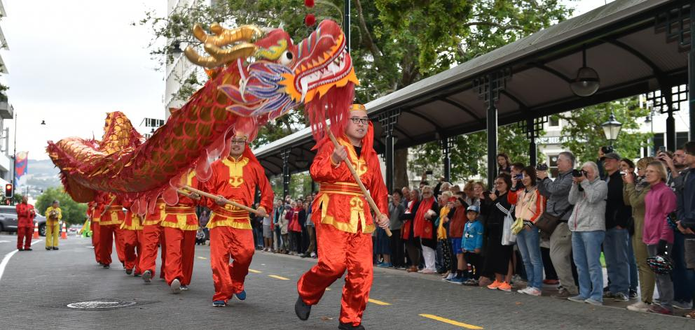 Several hundred people gathered in the Octagon to watch dragon dancing at the Chinese New Year celebrations in Dunedin this evening. Photo: Gregor Richardson