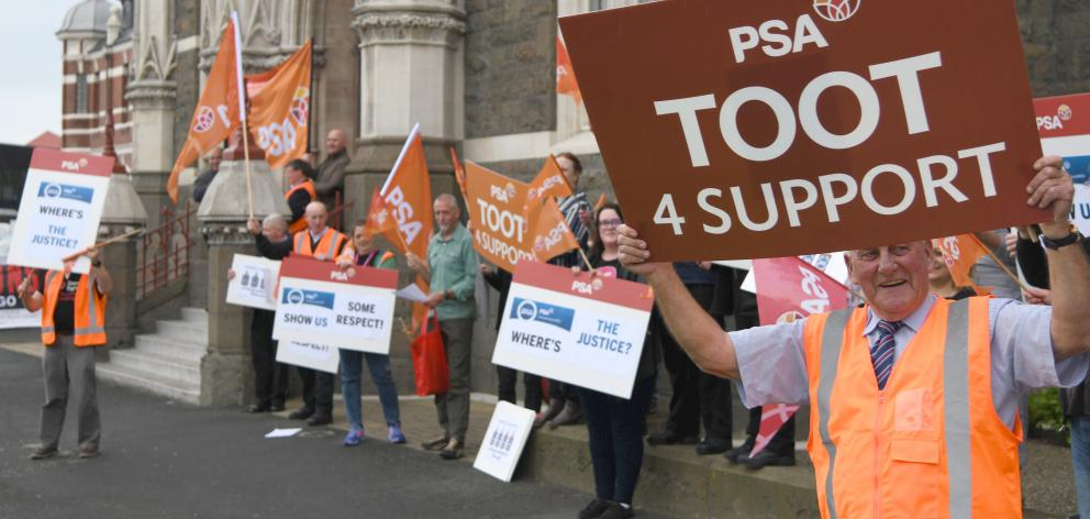 Dunedin District Court staffer Dave Pegg protests along with other court workers, lawyers, and members of other unions. Photo: Craig Baxter