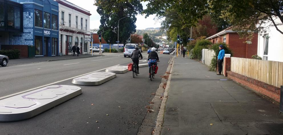 Cyclists on a section of the new cycle lane near the University of Otago. Photo: NZTA