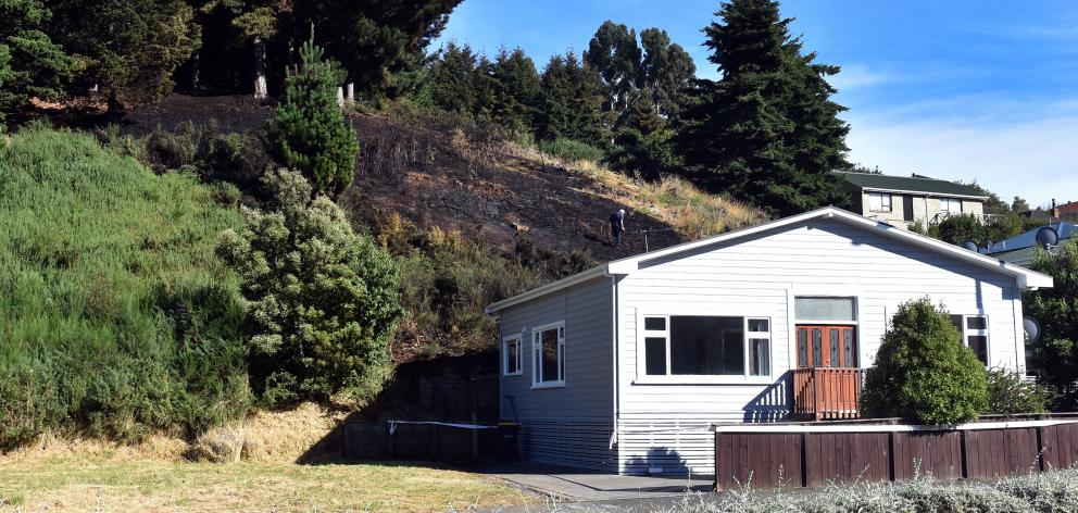 A vegetation fire in Kaikorai Valley Rd early yesterday came perilously close to at least one...