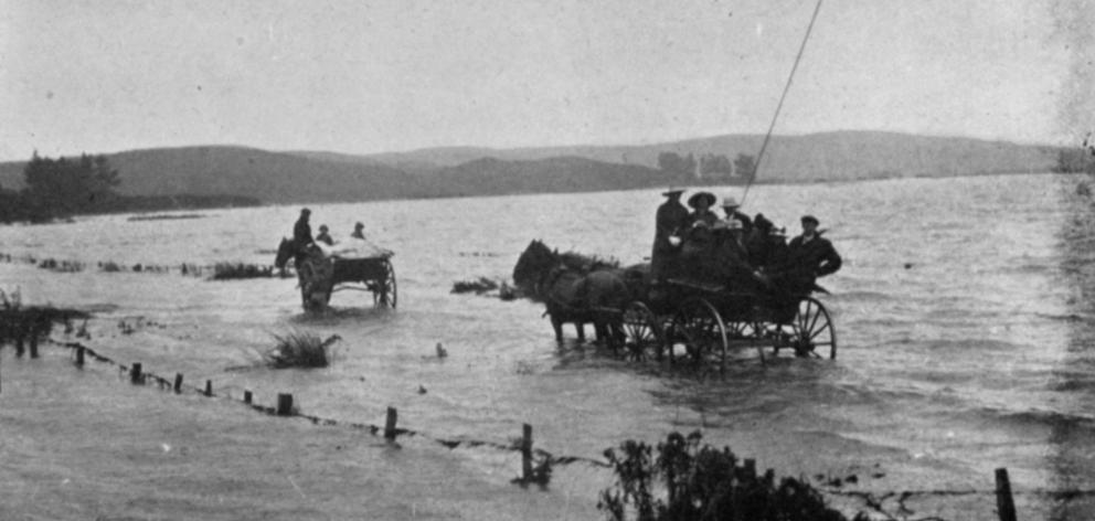 On the Lovells Flat-Kaitangata Road: Schoolteachers travel by buggy on the way to resume their...