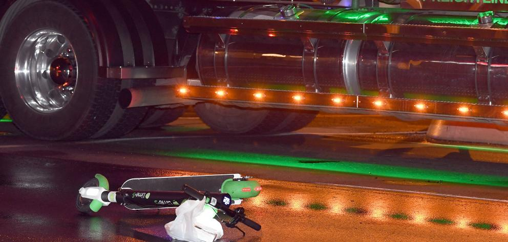 A Lime e-scooter lies on the road beside a truck after a crash in the early hours of this morning...