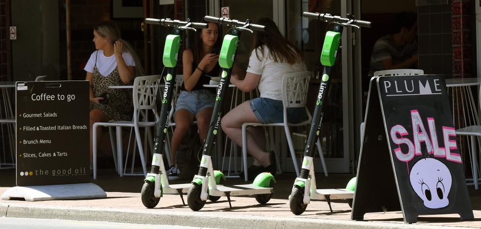 Lime scooters are parked on the footpath in George St, Dunedin. Photo: Stephen Jaquiery