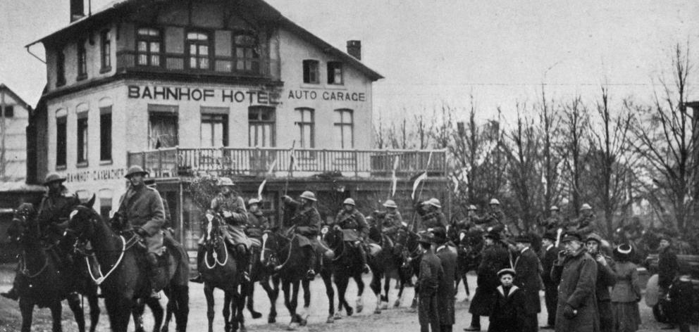 The first entry into a German town after the armistice: British lancers entering Malmedy. — Otago Witness, 26.2.1919.