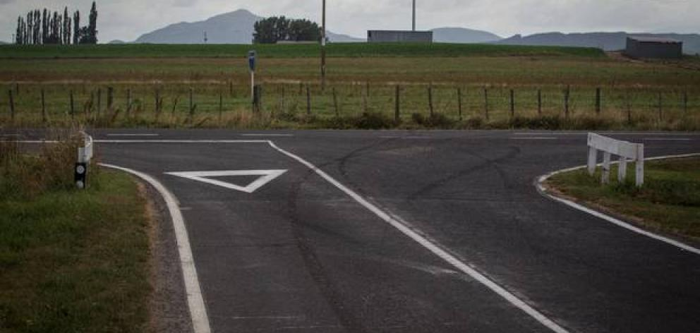 Tyre marks can be seen on Massey Rd where a woman crashed and died on Sunday night. Photo: Stephen Parker