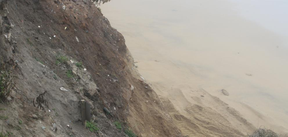 Coastal erosion has revealed two informal landfill sites along Beach Rd, south of Oamaru.