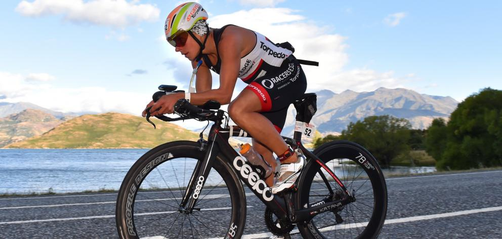 Simone Maier, from Wanaka, settles into the long ride in Challenge Wanaka as she heads towards...