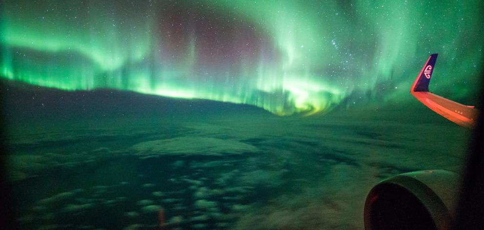 """The aurora australis viewed from """"Flight to the Lights'', in March 2017. PHOTO: BRAD PHIPPS"""