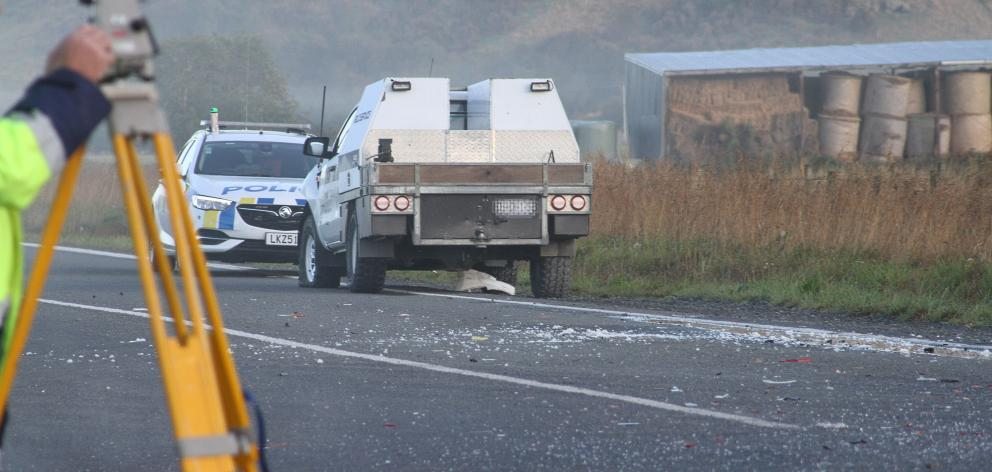 Police carry out investigations at the accident site this morning. Photo: John Cosgrove