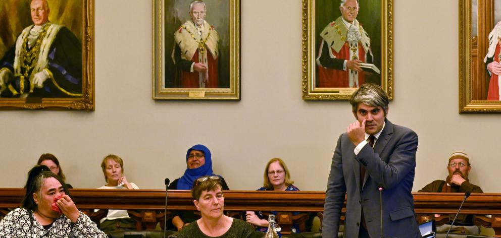 An emotional Dunedin city councillor Aaron Hawkins (right) urges the community to tackle racism in all its forms, flanked by (from left) Cr Marie Laufiso and Cr Rachel Elder, at yesterday's Dunedin City Council meeting. Photo: Christine O'Connor