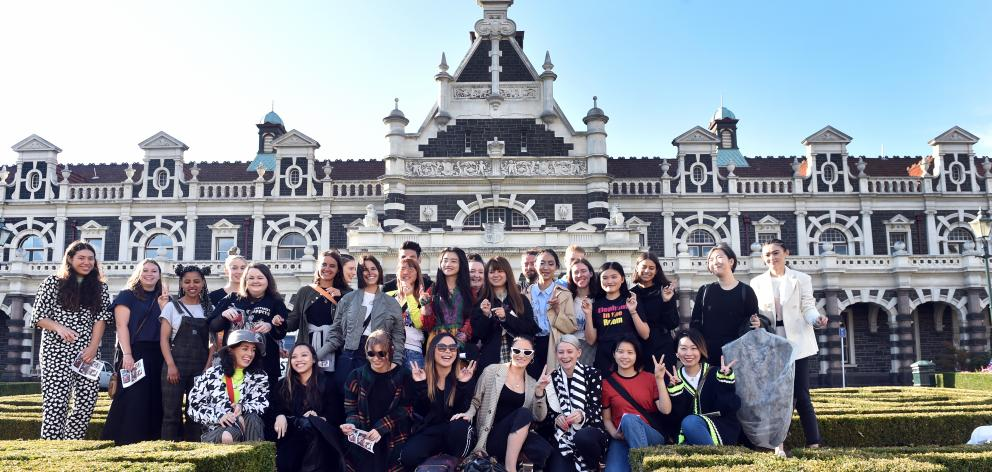 A group of emerging designers gather for their designs to be photographed at the Dunedin Railway Station. Photo: Peter McIntosh