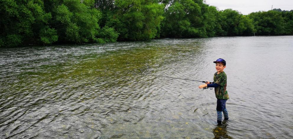 Fletcher Pettersson (6) fishes the Mataura River, after gaining access via the Pemberton family's farm. PHOTO: MATT PETTERSSON