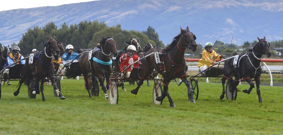 Franco June and driver Mark Hurrell fight off the challengers to win at Wingatui yesterday. PHOTO...
