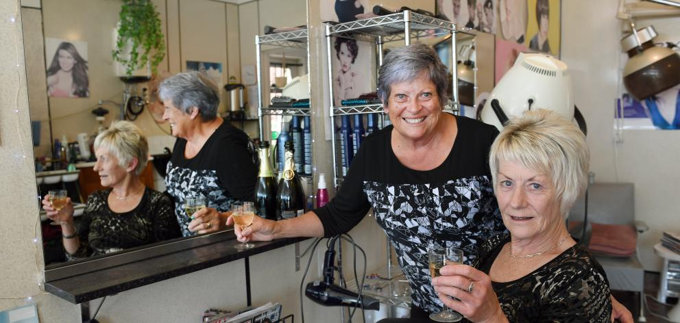 Retiring hairdresser Jenny Hyslop and her ``apprentice'' Joy Rowe (seated) at Dawn Salon in South Dunedin. Photo: Stephen Jaquiery