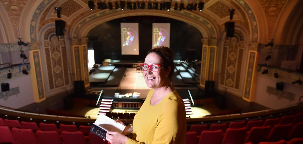 iD Dunedin Fashion Week spokeswoman Nicola McConnell flicks through an event programme at the...