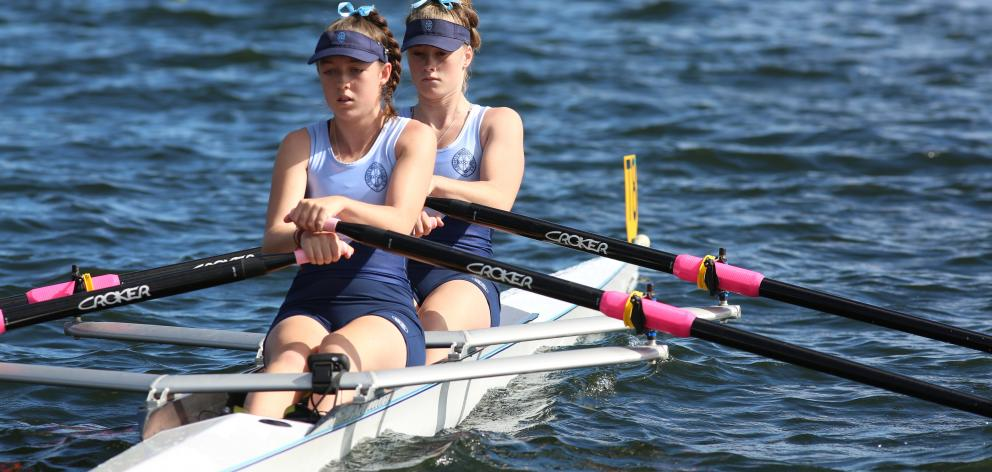 St Hilda's Collegiate duo Millie Davenport (front) and Sophie Smith compete in the under-16 girls double sculls at the Maadi Cup at Lake Karapiro. Photo: Sharron Bennett