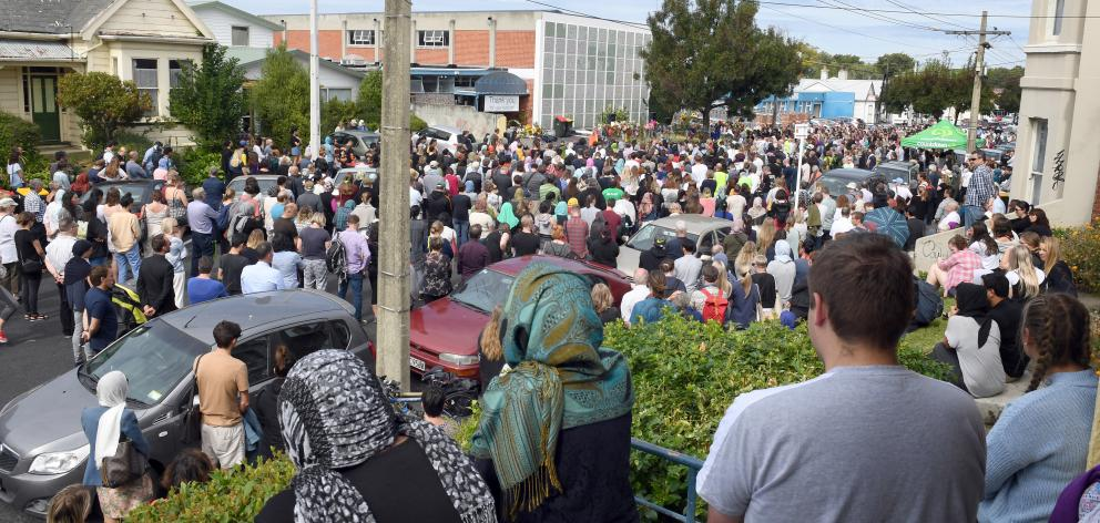 About 1000 people gather outside the Al Huda mosque yesterday. PHOTO: STEPHEN JAQUIERY
