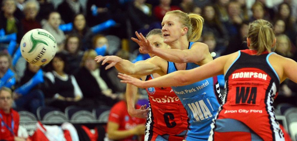 Shannon Francois passes the ball for the Southern Steel against the Mainland Tactix as Jade...