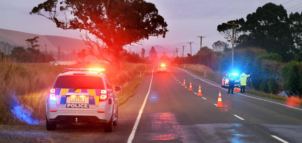 Police work at the scene of a fatal car accident near Palmerston yesterday. Photo: Stephen Jaquiery