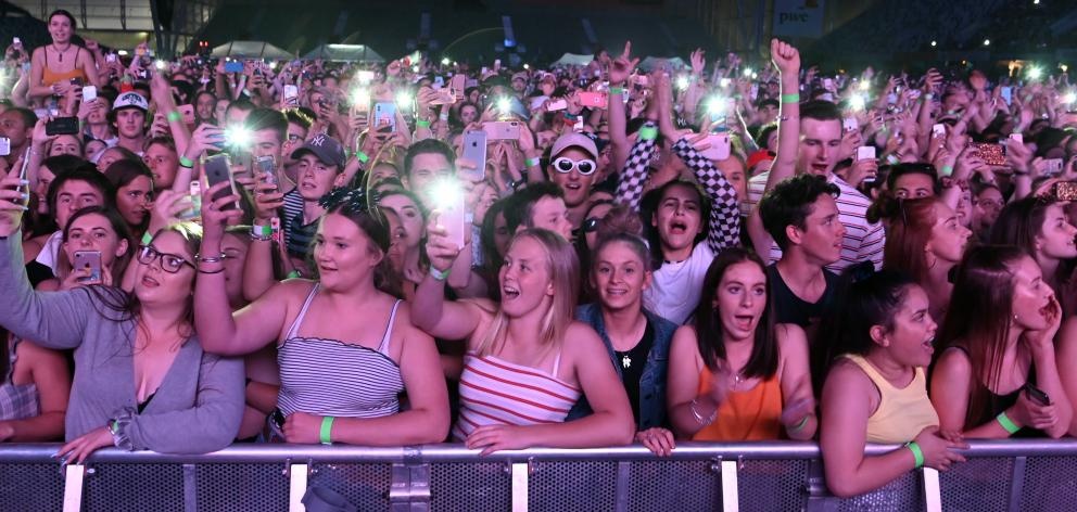 Concert-goers photograph themselves at the Six60 concert.