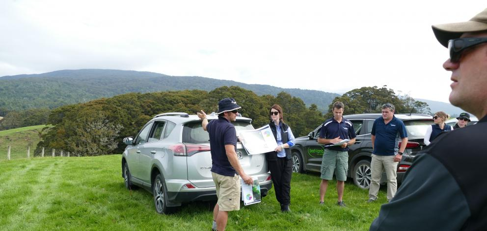 Pourakino farmer Geordie Eade (centre) discusses the paddock maps with farmers at last week's field day. Claire Bekhuis, from Ballance Agri-nutrients, is helping with the map. Photo: Ken Muir