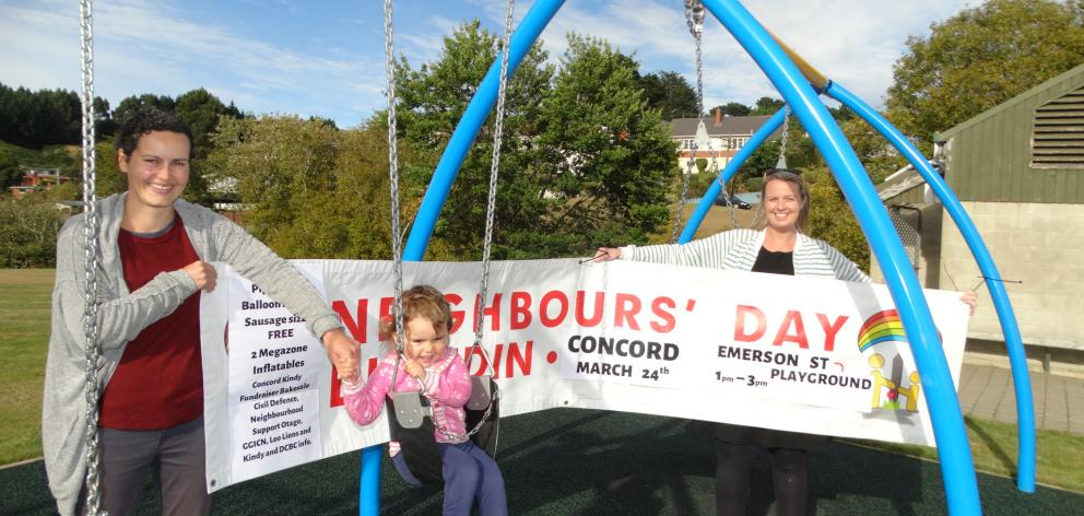 Preparing to host a Neighbours Day community event at Concord reserve this Sunday are (from left) resident Janna Kyle with daughter Catherine (2) and Greater Green Island Community Network worker Amanda Reid. Photo: Brenda Harwood