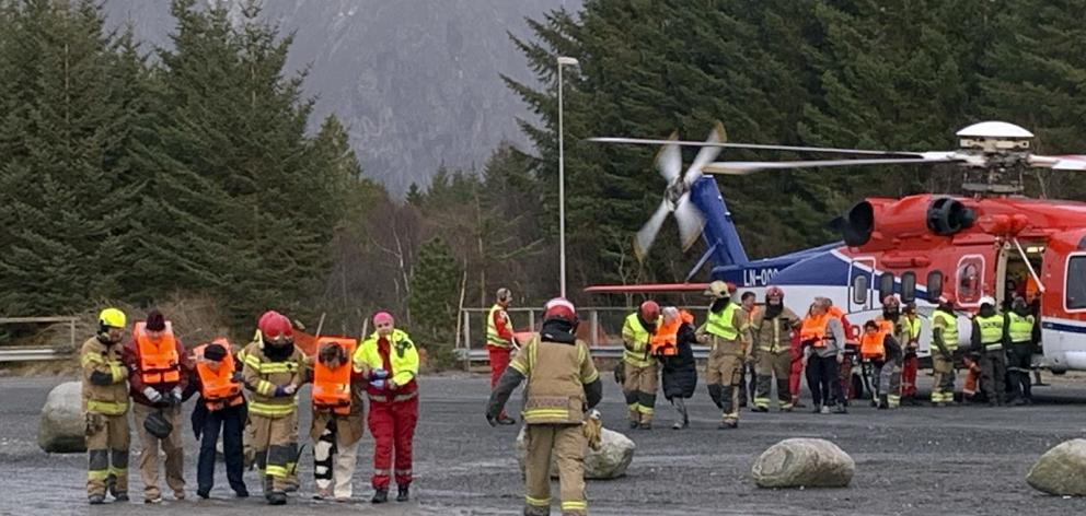 Passengers rescued from the Viking Sky cruise ship are helped from a helicopter in Hustadvika, Norway. Photo: Odd Roar Lange/NTB Scanpix via AP