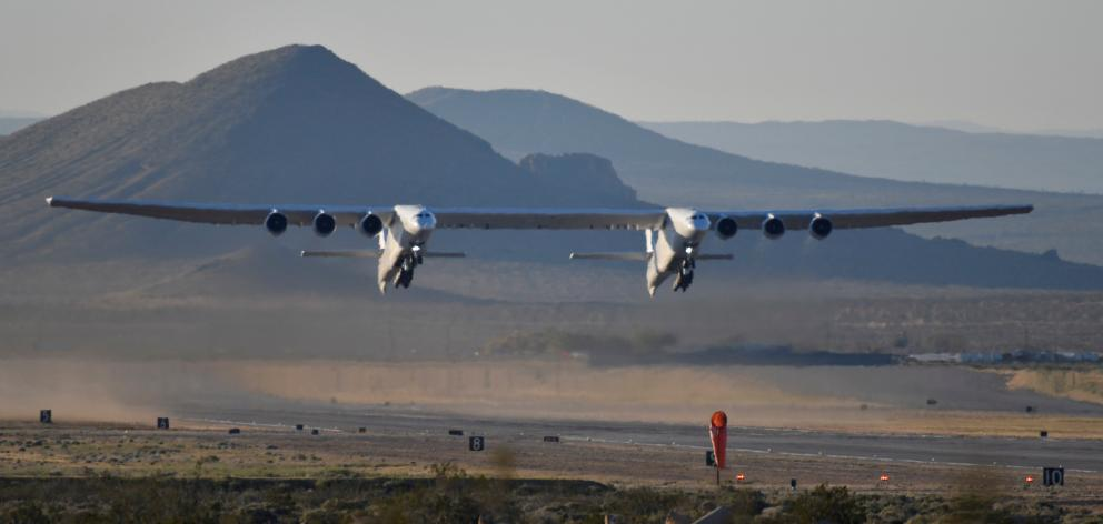 The world's largest airplane, built by the late Paul Allen's company Stratolaunch, makes its...