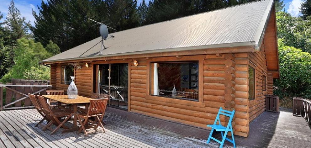 An American couple are selling their alpine-style log house on Corsican Drive. Photo: Supplied