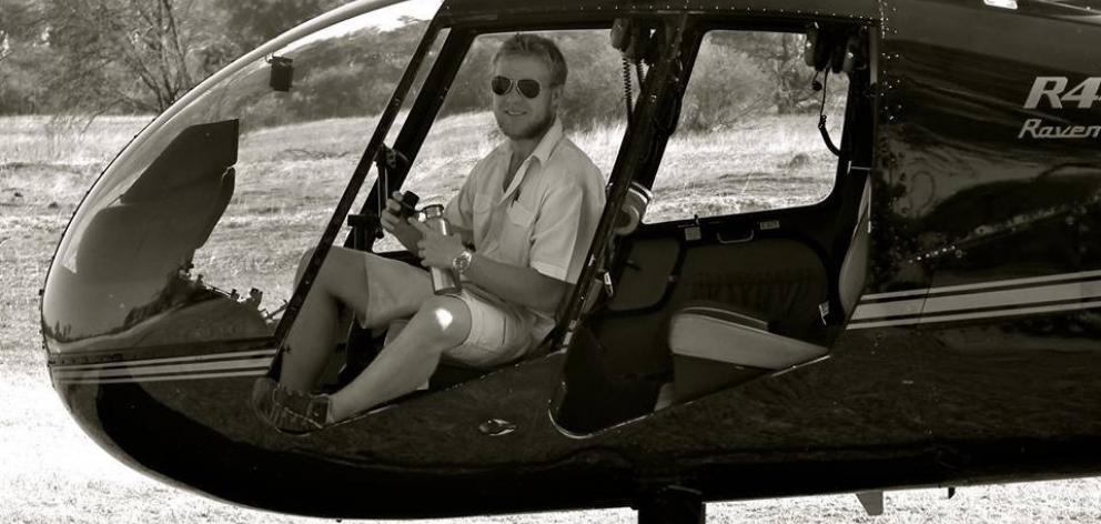 Mitch Gameren at the controls of a helicopter during a stint working in Botswana.