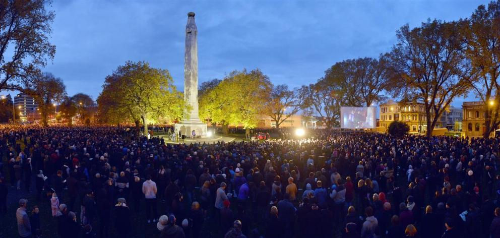 The first rays of sunshine appear over the Cenotaph in Dunedin during the dawn service yesterday....