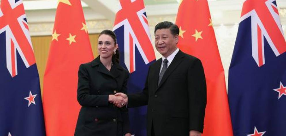 Chinese President Xi Jinping, right, and Prime Minister Jacinda Ardern shake hands before their meeting at the Great Hall of the People in Beijing. Photo: AP