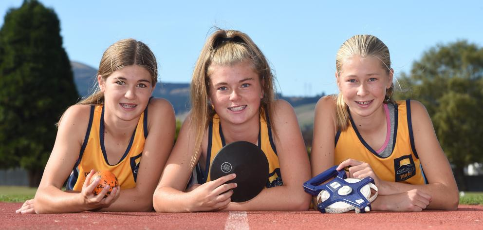 Beattie sisters Shyah, Zharna and Neve compete with each to throw or jump further. Photo: Gregor Richardson