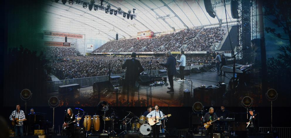 Big screens give fans a close-up of the Eagles performing at Forsyth Barr Stadium on Saturday.