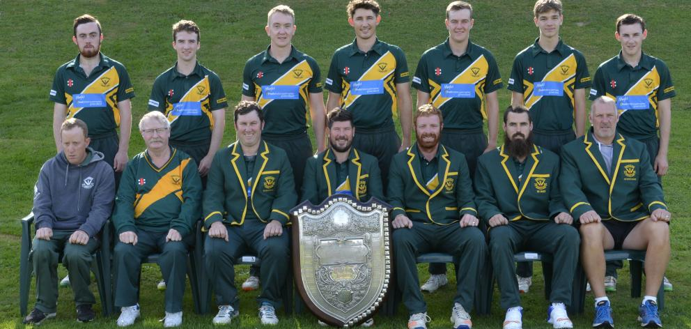 Lobb (front row, centre) props up the Bing Harris Shield after Green Island won it again this...
