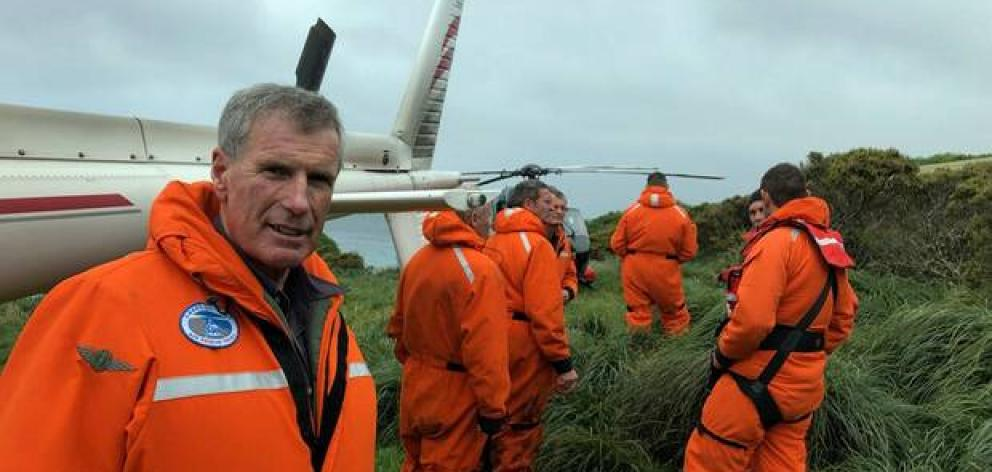 Southern Lakes Helicopters pilot and CEO Sir Richard Hayes on Enderby Island with others involved in the Auckland Islands rescue. Photo: Southern Lakes Helicopters