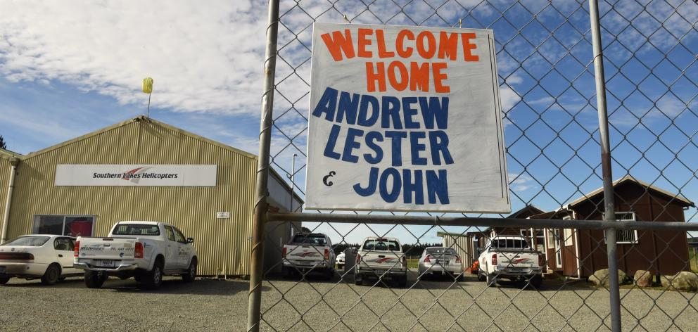 "A ""welcome home"" sign at Southern Lakes Helicopters for the trio who were involved in a helicopter crash in the Southern Ocean yesterday. Photo: Stephen Jaquiery"