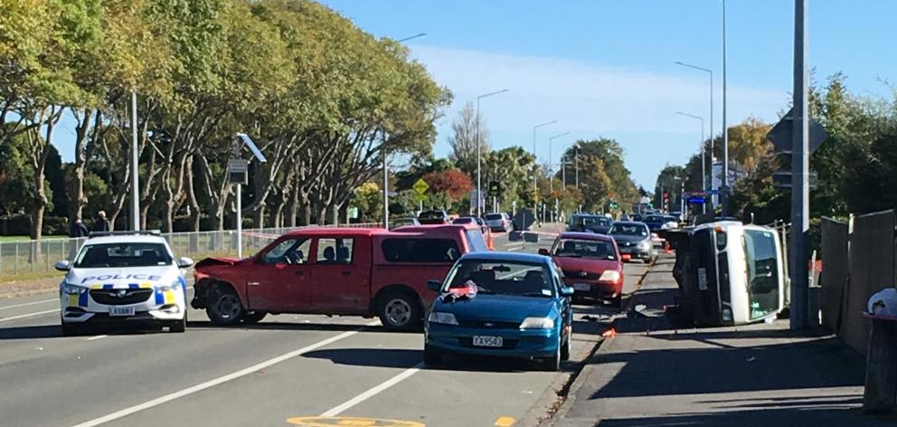 A van lies on its side after a police pursuit ended in a crash in Invercargill today. Photo: Abbey Palmer