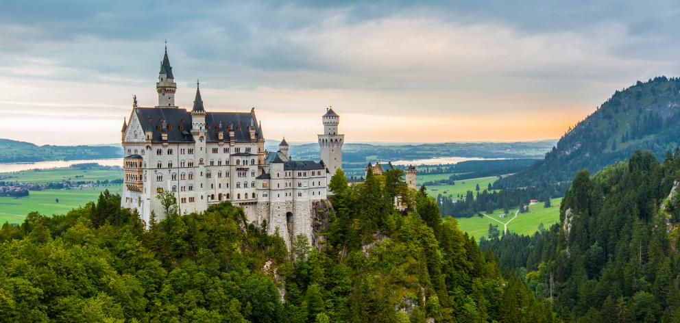 Sunset at Neuschwanstein Castle from Marienbrucke, Germany. Photo: Getty Images