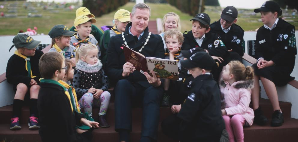 Waitaki Mayor Gary Kircher reads the picture book Anzac Ted - the story of a little boy's teddy...