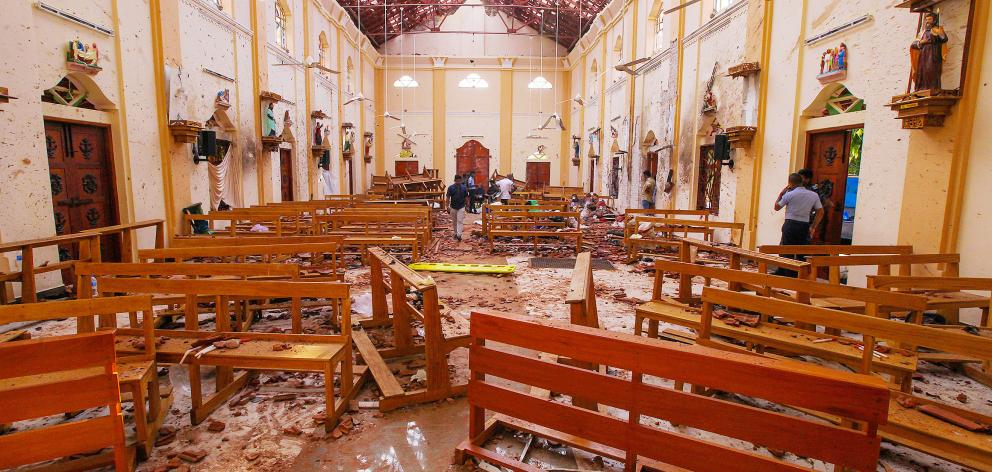 (NO ARCHIVE)Crime scene officials inspect the site of a bomb blast inside St Sebastian's Church in Negombo. Photo: Reuters